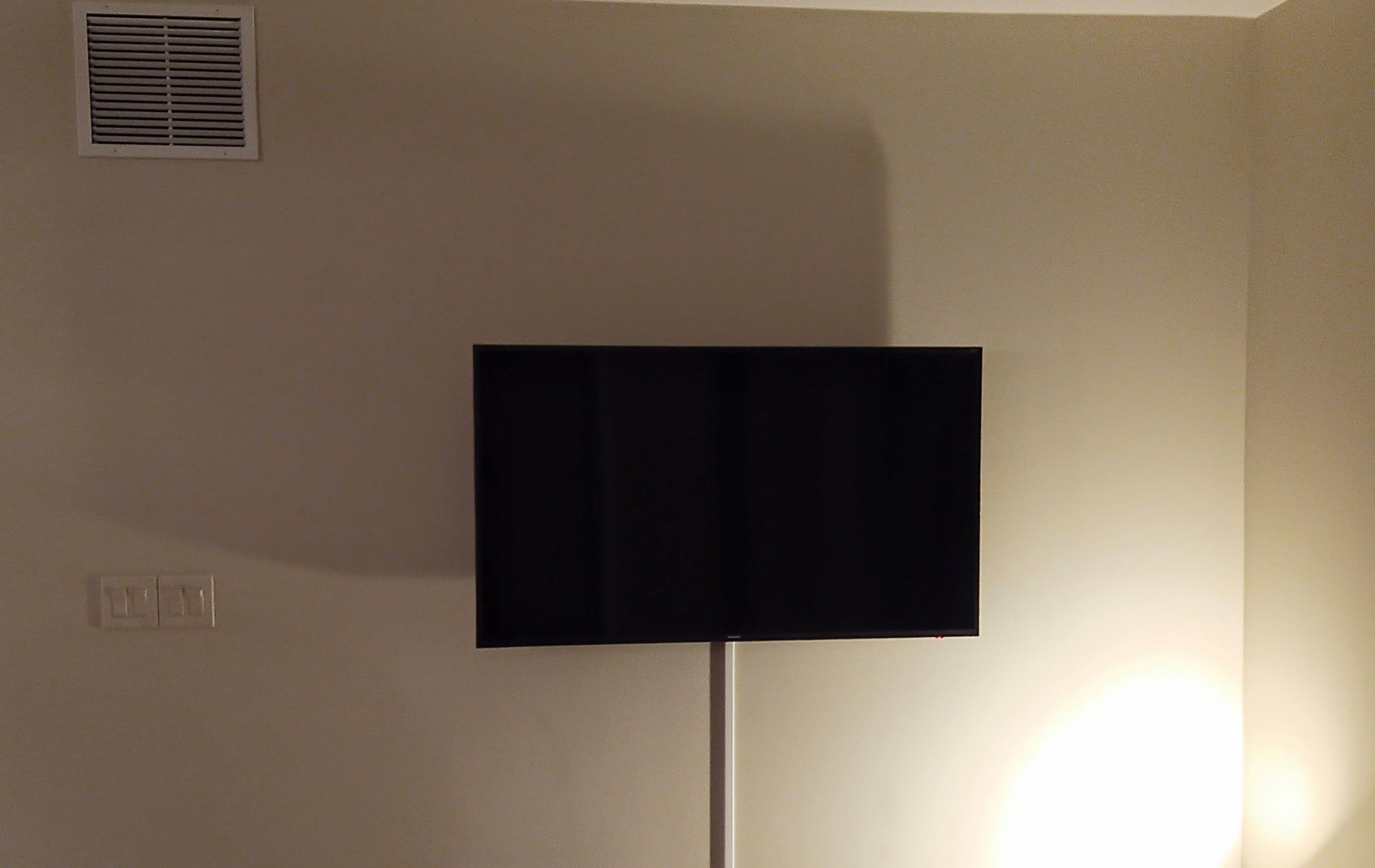 TV wall mounted installation with surface cord concealment