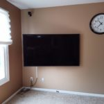 TV wall mounted TV wall mounted installation with surface cord concealment